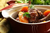 Traditional French cuisine - chicken in wine, coq au vin — Stock Photo
