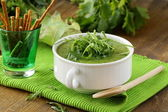 Cream soup broccoli with arugula greens in a white bowl — Stock Photo