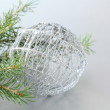 Christmas tree with decorations on gray background — Stock Photo