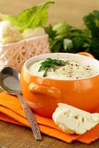 Cream soup of cauliflower with black pepper and parsley — Stock Photo