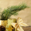 Stock Photo: Green fir branches and christmas decorations on a wooden background