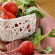Juicy organic radishes in a white basket — Stockfoto