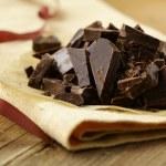 Black dark chocolate chopped into pieces — Stock Photo #15535983