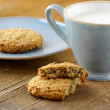 Oat cookies biscuits and cup of milk — Stock Photo