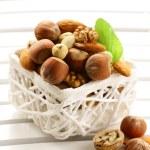 Mix nuts - walnuts, hazelnuts, almonds in a white basket — Stock Photo #15880763