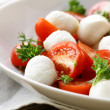 Stock Photo: ItaliCaprese salad with cherry tomatoes and baby mozzarella