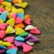 Small sugar candy in the form of hearts - 图库照片