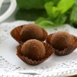 Chocolate candy  truffle with fresh mint - Stock Photo