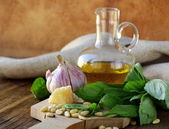 Ingredients for pesto, basil, olive oil, pine nuts, garlic and parmesan — Stock Photo