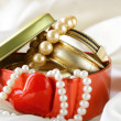 Gift box with gold and pearl jewelry - Stock Photo