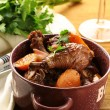 Stock Photo: Chicken in wine, coq au vin - traditional French cuisine