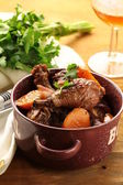 Chicken in wine, coq au vin - traditional French cuisine — Stock Photo