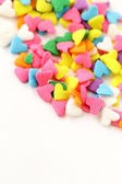 Small sugar candy in the form of hearts — Stock Photo