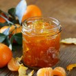 Orange mandarin homemade jam marmelade in a glass jar — Stock Photo