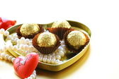 Box of chocolates and pearl, gift for Valentine's Day — Stock Photo