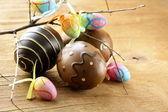 Easter decor eggs on wooden background — Stockfoto