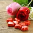 Stock Photo: Fresh roses and gifts for the holiday Valentines Day