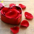 Petals of red roses in box — Stok Fotoğraf #17855463