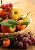 Various autumn fruits (pears, apples, mandarin and grapes) — Stock Photo