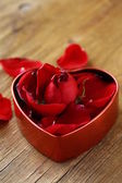 Petals of red roses in a box — Stock Photo