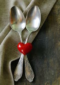 Vintage silver cutlery on a wooden background — Stock Photo
