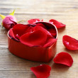 Petals of red roses in box — Stok Fotoğraf #18126129