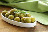 Green marinated olives with oregano — Stock Photo