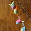 Easter decor eggs on wooden background — Stock Photo