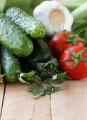 Fresh vegetables cucumber, tomato and garlic — Stock Photo