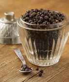 Black pepper on the board — Stock Photo