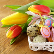 Decorated eggs and spring flowers tulips - symbols of Easter holiday — Stock Photo #18699693