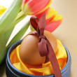 Stock Photo: Decorated eggs and spring flowers tulips - symbols of Easter holiday