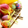 Decorated eggs and spring flowers tulips - symbols of Easter holiday — Stock Photo