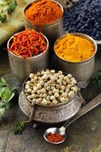 Various spices (turmeric, paprika, saffron, coriander) in metal bowls — Stock Photo