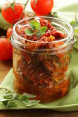 Sun-dried tomatoes with herbs and olive oil — Stock Photo