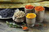 Various spices (turmeric, paprika, saffron, coriander) in metal bowls — Stock Photo