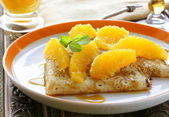 """crêpes suzette"" pancakes with orange and sweet sauce — Stock Photo"