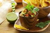 Guakomole and corn chips - avocado and tomato dip — Stock Photo