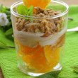 Stock Photo: Orange dessert with cream and biscuits in glass