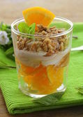 Orange dessert with cream and biscuits in a glass — Stockfoto