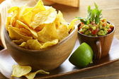 Corn tortilla chips in a wooden bowl — Stock Photo