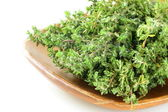 Bunch of organic thyme on a wooden plate — Stock Photo