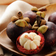 Stock Photo: Fresh exotic fruit mangosteen on wooden plate