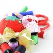 Sewing utensils - coils colored threads, pins, thimble - Stock Photo