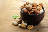 Mix nuts - walnuts, hazelnuts, almonds on a wooden table — Stock Photo