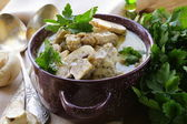 Stew chicken in a creamy sauce with mushrooms — Stock Photo