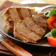 Beef steak grilled with fresh salad garnish — Stock Photo