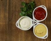 Mustard, ketchup and mayonnaise - three kinds of sauces — Stock Photo