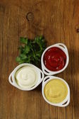Mustard, ketchup and mayonnaise - three kinds of sauces — Stok fotoğraf