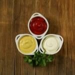 Mustard, ketchup and mayonnaise - three kinds of sauces — Stock Photo #23074006